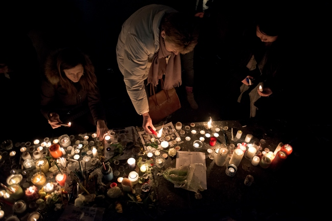 After the historic gathering of nearly 4 million people, the night continues on the Republic Square for tributes to the victims of the attacks in Paris. Paris, January 11, 2015, Paris, France. Photo by Nicolas Messyasz / Sipa Press